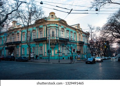 ODESA, UKRAINE - MARCH 05, 2019: evening street view on buildings, cars and people