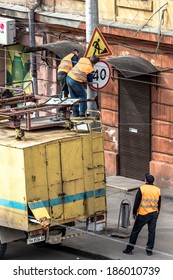 Odessa - April 7: Road workers on the cover of a specialized truck crane mounted on a city street new signs, April 7 2014, in Odessa, Ukraine