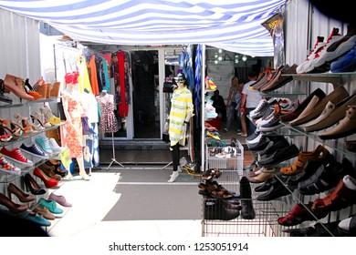 ODESSA, UKRAINE - 05.16.2016. People visit the shoe store in 7km Market, Odessa, Ukraine. The Seventh-Kilometer Market,Russian: Промрынок 7ой километр, is an outdoor market outside of Odessa