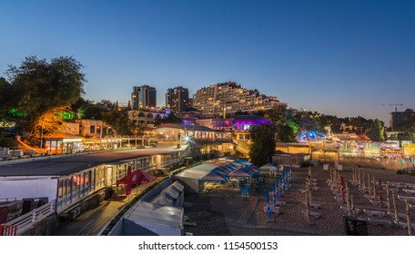 ODESSA, UKRAINE - 08.08.2018. Panoramic view of Arcadia city beach in a hot summer night. Famous touristic place in Ukraine