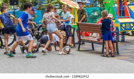 ODESSA, UKRAINE - 08.09.2018: Football for children - players of children's football. Children with parents play soccer on playground near house for entertainment. Healthy way of life, Children sport