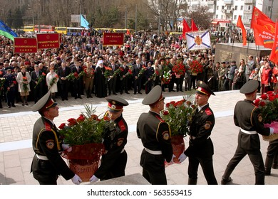 ODESSA, UKRAINE -10 April 2010: Ceremony laying flowers and flower wreaths in Memory Day. Victory Day of liberation of city. Veterans and people, priests solemnly honored memory of heroes World War II