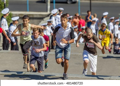 ODESSA, UKRAINE -10 September 2016: Athletes of all ages, fitness children, youth, adults and elderly run by Potemkin stairs  in physical sports holiday, Day of city. Competition Running up stairs