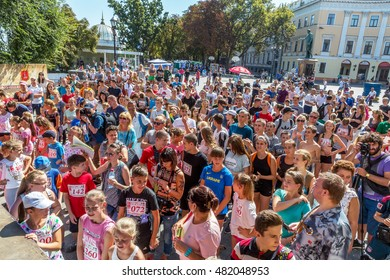 ODESSA, UKRAINE -10 September 2016: Spectators watch representation of parents and their children on urban scene during childhood holiday Day City. Audience delighted with performance of artists