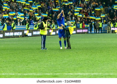 ODESSA, UKRAINE - 12 November 2016: Euro football match of the Champions League, European Qualifiers Ukraine  FC and the national team of FC Finland. 1: 0 Football fans in the stands of the stadium