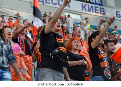 ODESSA, UKRAINE - 14 August, 2015: Football fans and spectators in  stands of the stadium emotionally support their team during  game of FC Shakhtar (Donetsk) - Dnipro (Dnipropetrovsk).  Ukrainian Cup