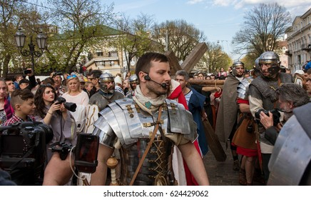 ODESSA, UKRAINE -15 April 2017: Historical reconstruction of the biblical events. The Crucifixion of Jesus Christ. Roman centurions, legionaries and crowds of parishioners in authentic clothes
