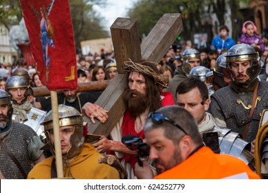 ODESSA, UKRAINE -15April 2017: Historical reconstruction of biblical events. Crucifixion of Jesus Christ. Way of Jesus Christ to Calvary with cross surrounded by legionnaires and crowd of parishioners