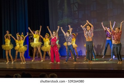 ODESSA, UKRAINE -17 December 2016: Children's musical performance cheerleaders on stage. Children's performance. Emotional children's stage show. Kids Cheerleading. Dancing on stage