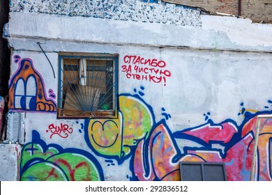 """Odessa, Ukraine -18 June 2015: Bullying gang graffiti painted the walls of buildings. Residents of homes are struggling with illegal graffiti. The inscription on the wall, """"Thank you for a clean wall"""""""