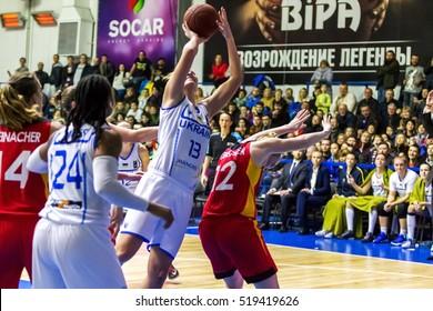 ODESSA, UKRAINE - 19 November 2016: European Basketball Championship for women. The national team of Ukraine adopts German national team. Wrestling athletes for ball on basketball court