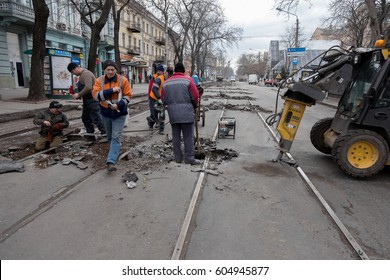 ODESSA, UKRAINE -20 March 2017: Repair of tramway. Capital repair of city road with tram line. Road Closed. Installation of rails of railway for tram. Repair and reconstruction of city square