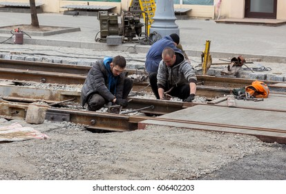 ODESSA, UKRAINE -20 March 2017: Repair of iron tram line. Installation railway rails for trams. Laying stone pavers, road paving slabs on street. Repair reconstruction of urban highways with tram line