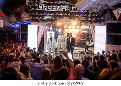 Odessa, Ukraine - 2014 July 27: Lagerfeld show. Fashion show on stage with many in audience.  Large crowd of people having fun in a nightclub  during the show.