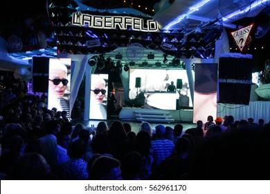 Odessa, Ukraine - 2014 July 27: Lagerfeld show. night club dj party people enjoy of music dancing sound with colorful light. club night light dj party Ibiza club. Go go dancer perfomance show.