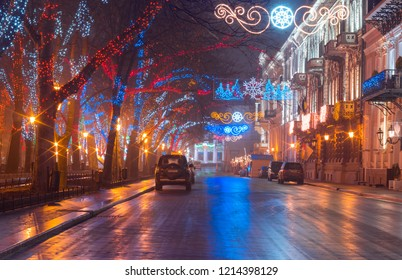 Odessa, Ukraine.- 23 December 2017: Christmas night view of the Old Town illuminated architecture with a lot of color street lights at Primorsky Boulevard, Odessa, Ukraine