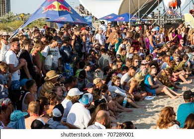 ODESSA, UKRAINE -25 August 2017: large crowd of spectators, fans at rock concert during music show during day. Spectators in sand of beach during music and sports festival Z-games. Selective focus