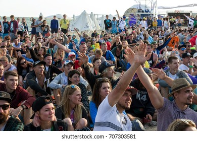 ODESSA, UKRAINE -25 August 2017: large crowd of spectators, fans at rock concert during music show during day. Spectators in sand of beach during music and sports festival Z-games