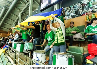 ODESSA, Ukraine -26January 2017: VC Khimick (Ukraine) in volleyball CEV Cup - women. 16 finals. Spectators and fans are emotionally support their national team in stands of closed sports hall, stadium