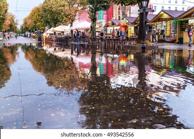 ODESSA, UKRAINE -3 October 2016: Rainy season. Street of city flooded with water after heavy rainfall. Large puddles on streets after rain. Ecological catastrophy. Global warming and climate change