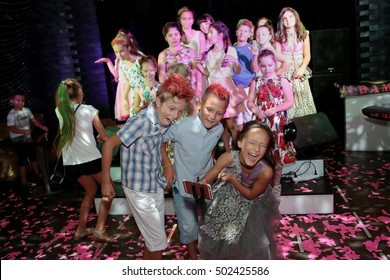 ODESSA, UKRAINE - 30 August 2016: The audience at the concert. Spectators children emotionally watching acrobatics and performance of children's fashion show. Baby spectators at Children's Festival