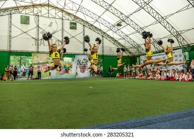 Odessa, Ukraine -30 May 2015: Cheerleading Championship of Ukraine among children. Children with a beautiful bright dance form Sportin show their skills.