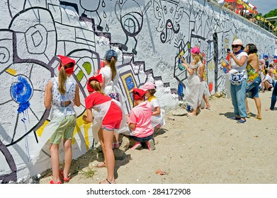 Odessa, Ukraine - 31 May 2015: Beautiful street art graffiti on wall of city. Abstract creative drawing fashion colors. Urban Contemporary Culture. people children paint graffiti on wall background