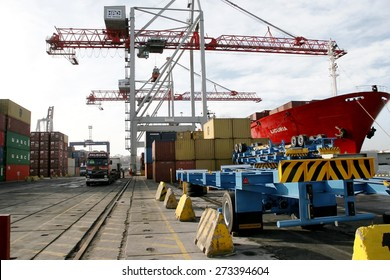 Odessa, Ukraine -5 December 2008: Sea container terminal. Marine cranes loads more shipping containers on a cargo ship. The storage area containers. Sea transportation of cargo