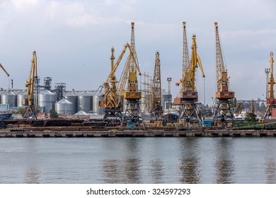 Odessa, Ukraine - 6 October 2015: Container cranes at the container terminal cargo port, cargo cranes without work in an empty port harbor. Crisis. Defaulted paralyzed the entire economy of the state