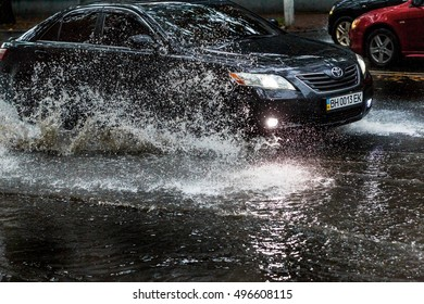 ODESSA, UKRAINE - 8 October 2016: Rainy season. Street of city flooded with water after heavy rainfall. Large puddles on streets after rain. Ecological catastrophy. Global warming and climate change