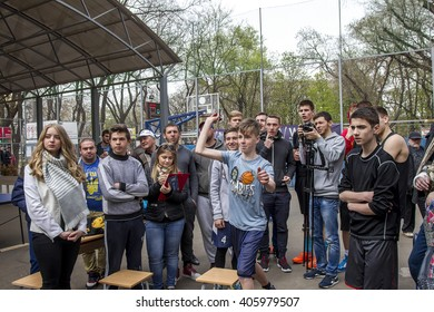 Odessa, Ukraine -9 April 2016: The game of darts at the sports festival. Athletes throw arrows at the target darts board during a game of darts.