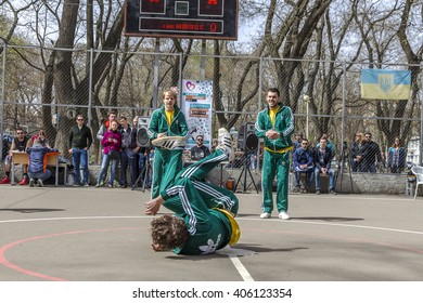 Odessa, Ukraine -9 April 2016: Breakdancers fighting competition on playground during summer holiday youth. Group of young men in tracksuits dancing youth Break dance