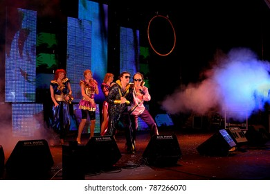 ODESSA, UKRAINE - April 1, 2008: Musical show on stage during holiday of humor in Odessa - Day of Durk. Artists perform on stage with circus performances. Musical concert, performance, fire-fighters