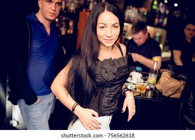 Odessa, Ukraine April 1, 2016: Park night club. Women smiling and posing on cam during concert in night club party. Girl have fun at club. girl at night club party
