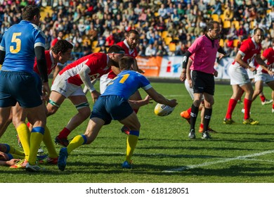 ODESSA, UKRAINE - April 1, 2017: European Rugby Championship national team of Ukraine - Portugal. Intense struggle of players in rugby for ball. Dynamic game on green field of stadium