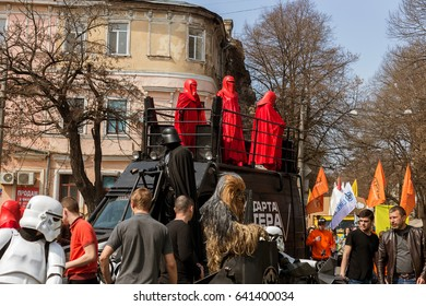 Odessa, Ukraine - April 1, 2017: Darth Vader, Chewbacca and assault soldiers posing for Humor Parade on April Fool's Day in Odessa. Heroes Star Wars Storm Trooper among people and Selfies