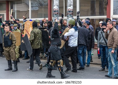ODESSA, UKRAINE - April 10, 2014 : Riots Ukrainian nationalists Nazis on the streets. Hooligans armed groups are preparing to battle April 10, 2014 in Odessa , Ukraine.