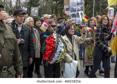 ODESSA, UKRAINE - April 10, 2016: Celebration of Victory Day - Day of Liberation of Odessa. Veterans and city residents bring flowers to the Eternal Flame, Tomb of the Unknown Sailor.