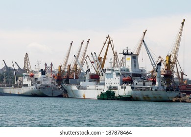 ODESSA, UKRAINE - APRIL 10: maritime cargo ship is under loading cranes Ukrainian industrial goods in the harbor seaport, April 10, 2014 Odessa, Ukraine
