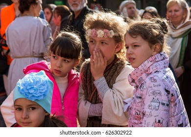 ODESSA, UKRAINE - April 17, 2017. Crowd spectators on street during an artistic presentation about reconstruction of biblical events - Cross Procession of Jesus Christ. Costumed viewers on the street