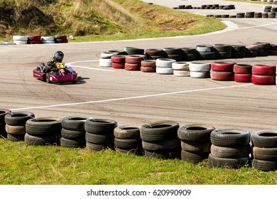 ODESSA, UKRAINE - APRIL 2, 2017: Competitions on the picture, pilots in helmet and in racing clothes participate in the card race. Carting show. Children and adult racers on bright branded maps.