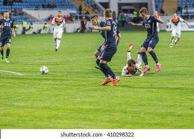 "ODESSA, UKRAINE - April 23, 2016: Football Team Super Champions League ""Shakhtar"" - Donetsk and ""Chernomorets"" - Odessa. Tense game tough rivals on the football field. League Pari-Match"