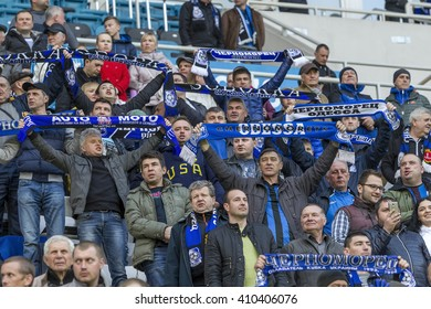 "ODESSA, UKRAINE - April 23, 2016: Football Team Super League champions ""Shakhtar"" - Donetsk and ""Chernomorets"" - Odessa. Fans in the stands Chernomorets show their support for the team during the game"
