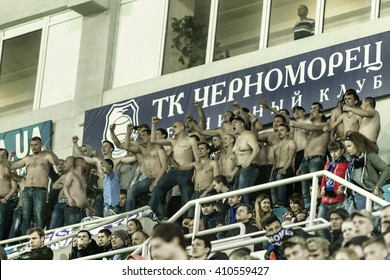 """ODESSA, UKRAINE - April 23, 2016: Football Team Super League champions """"Shakhtar"""" - Donetsk and """"Chernomorets"""" - Odessa. Fans in the stands Chernomorets show their support for the team during the game"""