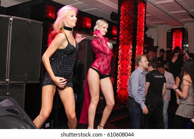 Odessa, Ukraine April 28, 2012: People make selfy, drink alcohol, dancing, smiling, smoking hookah and kissing during concert in night club party. Man and woman have fun at club
