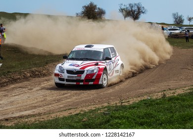ODESSA, UKRAINE - April 30, 2017: Traditional rally Autocross Championship. Racing car is dangerous enters steep turn of race course, scattering, spraying dirt, dust. Extreme rally driving autocross