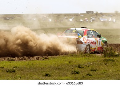 """ODESSA, UKRAINE - April 30, 2017: Traditional international rally """"Severin"""". Racing car is dangerous enters steep turn of race course, scattering, spraying dirt, dust. Extreme rally driving, autocross"""