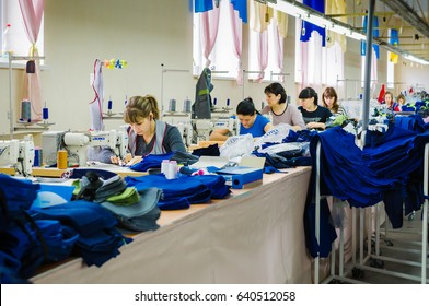 Odessa, Ukraine - APRIL 5, 2017:  Group of  factory workers sew jeans clothes in garment factory