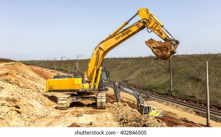 ODESSA, UKRAINE - April 7, 2016: Workers using heavy machinery repairing the railway line. Excavators, special technique on reconstruction of the railway rails