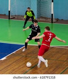 ODESSA, UKRAINE - April 7, 2017: Football on floor, minifootball.  Regional tournament of local clubs on futsal. bright moment of sports game mini football in closed hall